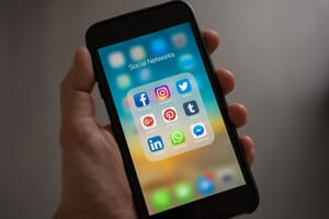 An iPhone displaying icons for popular social media channels that are ideal for video marketing distribution.